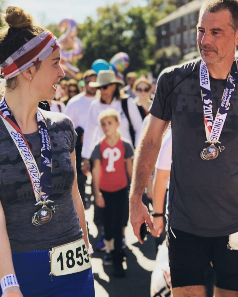 Emma and her dad Scott look at each other shortly after crossing the race finish line.