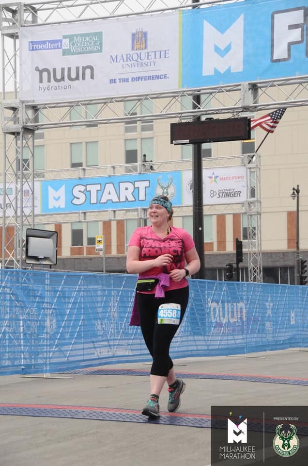 Picture of Danielle Schrupp (NPMKE tribe member) crossing the finish line of the Milwaukee Half Marathon!