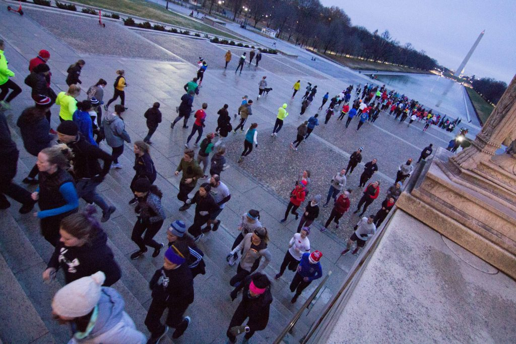 The crowds of people run up the stairs at the Lincoln Memorial