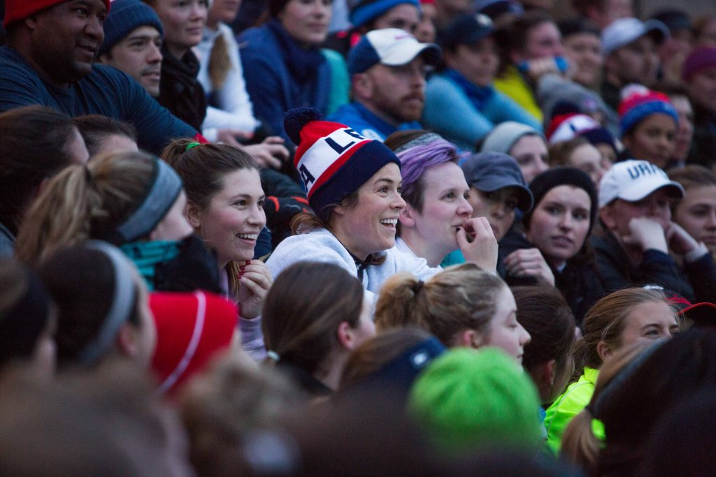 A photo of Kelley O'Hara sitting in the crowd during announcements