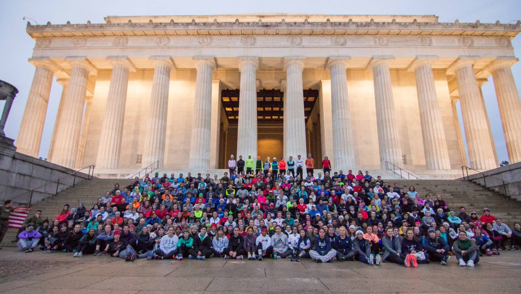 a group photo from the steps of the Lincoln Memorial