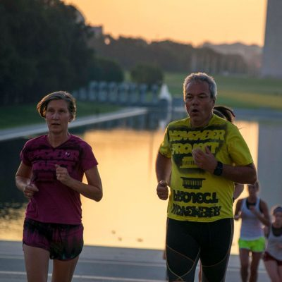 Ron Buch and Deb running up the Lincoln memorial steps