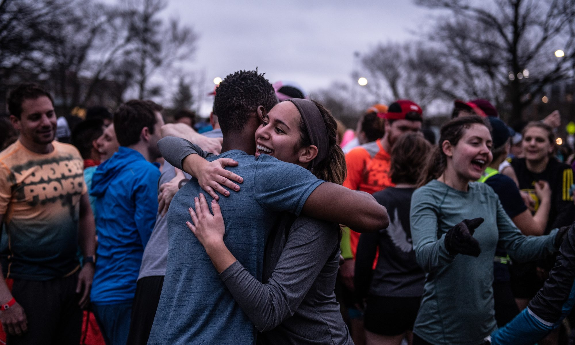 November Project Members embrace at Pre-Boston-Marathon workout
