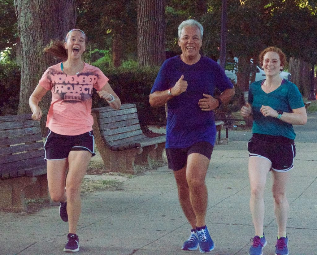 Hannah smiles while running next to two others, Ron and Julie, at a Monday workout.