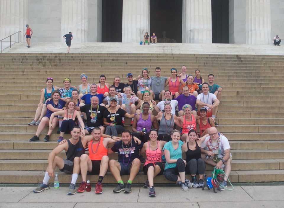 Maddie sits with the 5:25 Wednesday crew on the stairs of the Lincoln Memorial at The Unicorn workout in June.