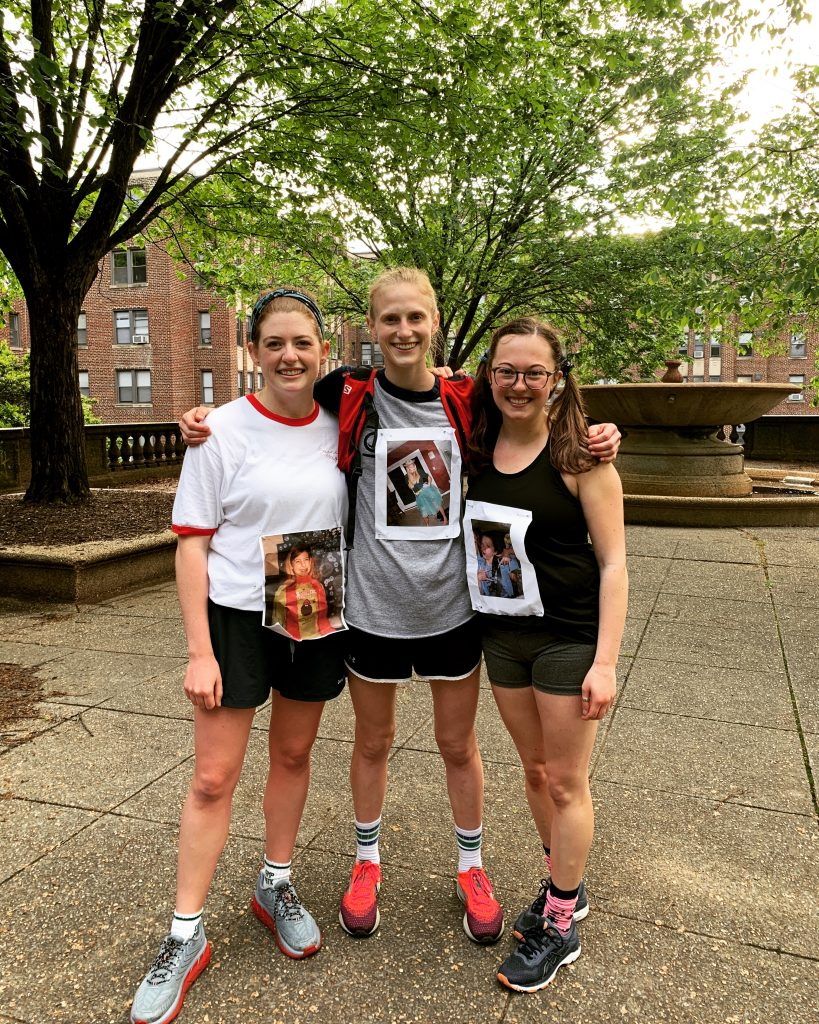 Maddie stands with friends Libby and Kyra after they guest-led a Monday workout at Meridian Hill/Malcolm X Park. They all wear middle school photos of themselves pinned to their shirts.