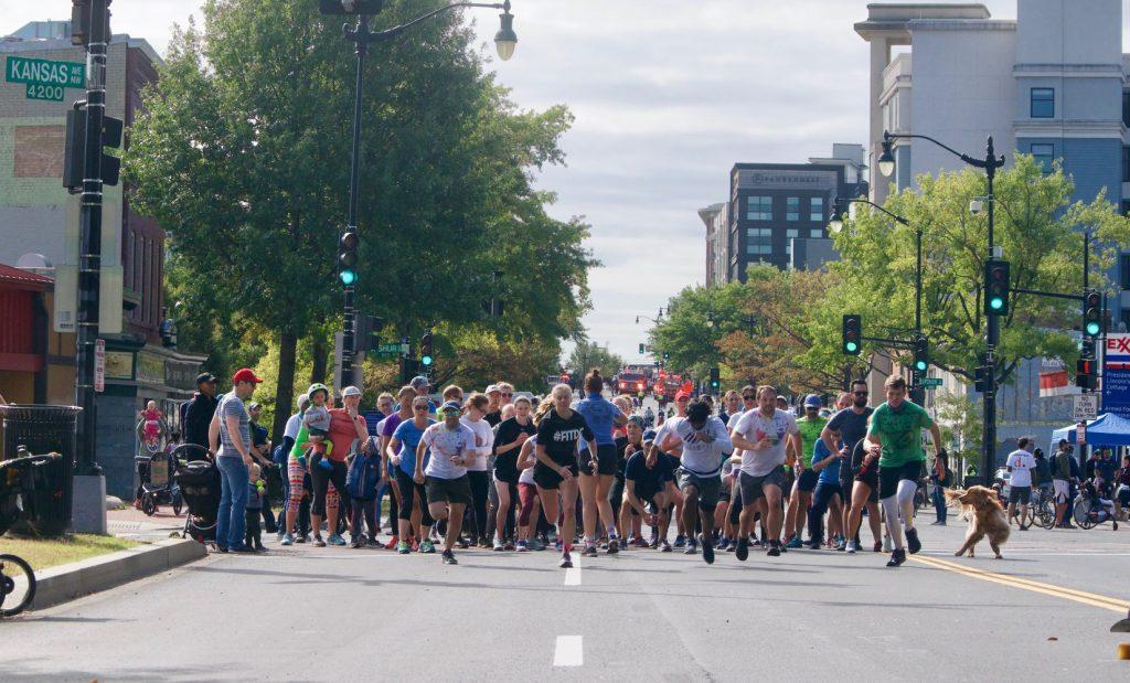 Runners begin a sprint on Georgia Avenue.